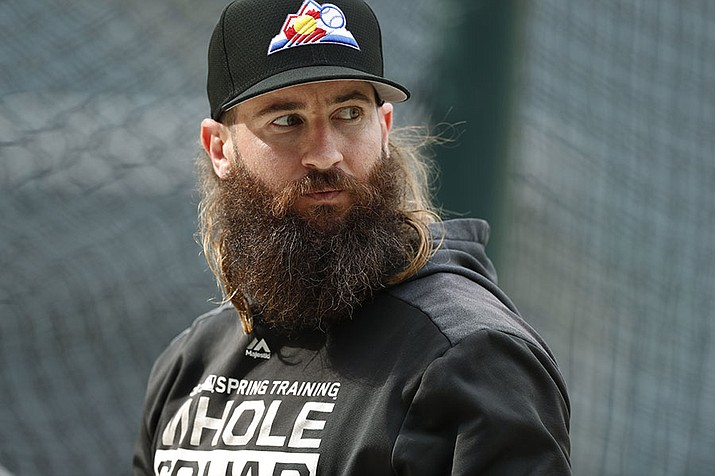 FILE - In this Sept. 11, 2019, file photo, Colorado Rockies right fielder Charlie Blackmon waits to enter the batting cage before the team's baseball game against the St. Louis Cardinals in Denver. All-Star outfielder Charlie Blackmon of the Colorado Rockies has become the first Major League Baseball player known to have tested positive for the coronavirus. A person familiar with Blackmon's situation confirmed the test result to The Associated Press on condition of anonymity because there was no official announcement. (AP Photo/David Zalubowski, File)