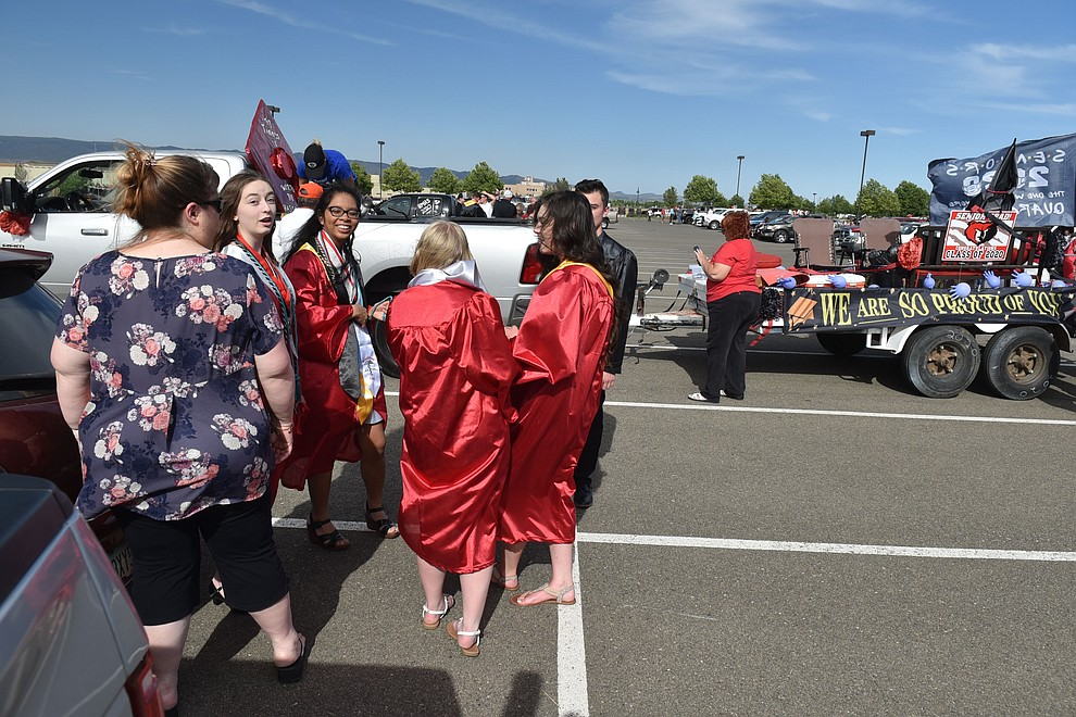 Graduating seniors from Bradshaw Mountain Highschool gather in the parking lot of Findlay Toyota Center in Prescott Valley on Wednesday, June 24 2020, awaiting their graduation parade ceremony. (Jesse Bertel/Courier).