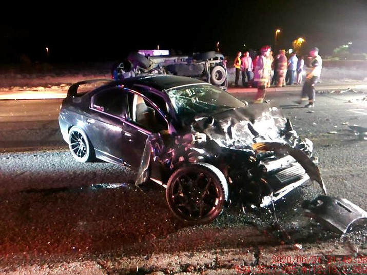 A black Dodge Neon was heavily damaged after its driver allegedly drove it into oncoming traffic along Highway 69 in Prescott Valley Wednesday night, June 24, 2020. (PVPD/Courtesy)