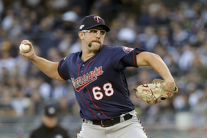In this Oct. 5, 2019, file photo, Minnesota Twins starting pitcher Randy Dobnak (68) delivers against the New York Yankees during the first inning of Game 2 of an American League Division Series baseball game, in New York. Finally, major leaguers are on track to resume this virus-abbreviated 2020 season. The hiatus has provided a welcomed dose of extra family time for many, but the unprecedented idling this spring and summer for players used to being on the diamond daily has predictably created a collective antsy feeling around the game. (Frank Franklin II, AP file)