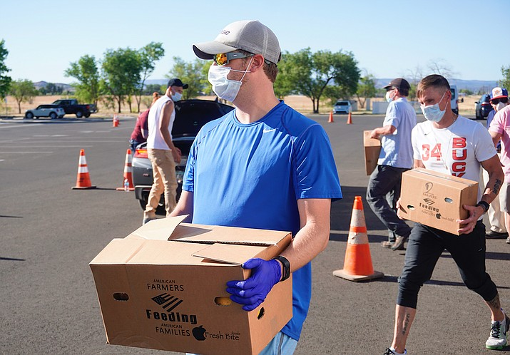 Chino Valley volunteers hand out food boxes to families that were struggling because of the coronavirus pandemic. (Chino Valley Salvation Army/Courtesy)