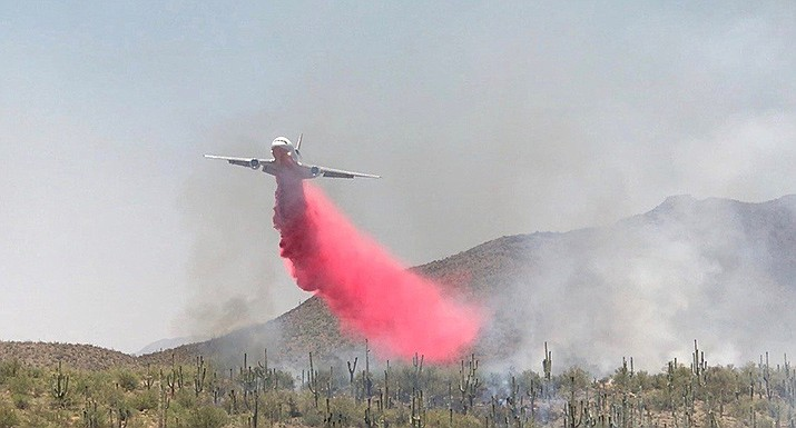 A plane drops chemicals on the Central Fire this week. There are several fires burning large acreage in Arizona now, with the Bighorn Fire being only 33 percent contained and close to Tucson-area structures. Courtesy of U.S. Forest Service