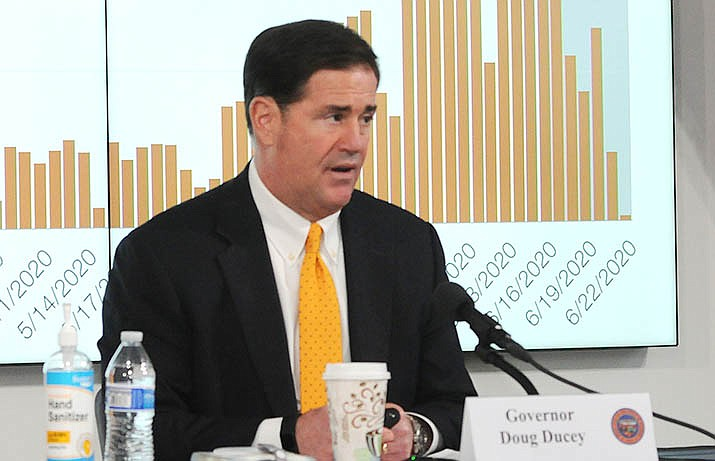 Gov. Doug Ducey discusses Thursday the increasing number of Arizonans infected with COVID-19 and how the only way to turn that around is more people staying home and wearing face masks. (Capitol Media Services photo by Howard Fischer)