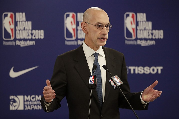In this Oct. 8, 2019, file photo, NBA Commissioner Adam Silver speaks at a news conference before an NBA preseason basketball game between the Houston Rockets and the Toronto Raptors in Saitama, near Tokyo. Silver said Friday that the concern shared by the league and its players surrounding next month's restart of the season is rising as coronavirus cases in Florida keep climbing.