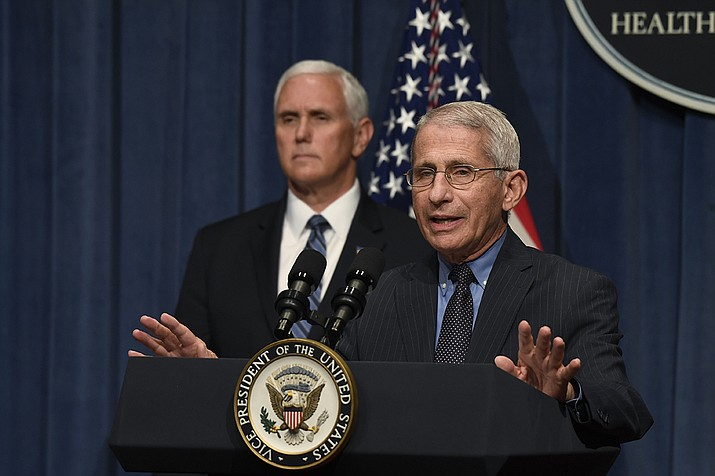 Dr. Anthony Fauci, right, director of the National Institute of Allergy and Infectious Diseases, speaks during a briefing with members of the Coronavirus Task Force, including Vice President Mike Pence, left, at the Department of Health and Human Services in Washington, Friday, June 26, 2020. (Susan Walsh/AP)