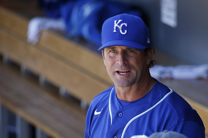 In this March 9, 2020 photo, Kansas City Royals manager Mike Matheny pauses in the dugout prior to a spring training baseball game against the Arizona Diamondbacks in Scottsdale, Ariz. Forget about those halcyon first few days of spring training, when arranging for the right tee time on the right golf course is often more challenging than the work on the field. When major leaguers report next week for spring training 2.0, time will be one precious commodity with about three weeks before opening day. (Ross D. Franklin/AP, File)