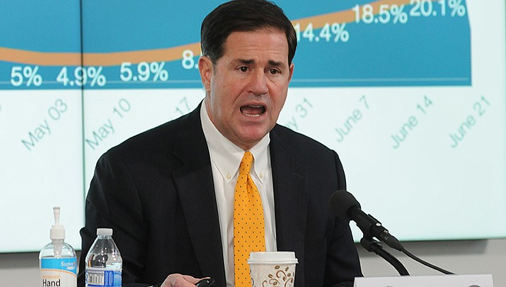 Arizona Gov. Doug Ducey talks to the media on Thursday, June 25. The governor said the only way the state can stop the rising tide of coronavirus cases would be for people to stay home when possible, and wear masks when in public. (Photo by Howard Fischer/For the Miner)