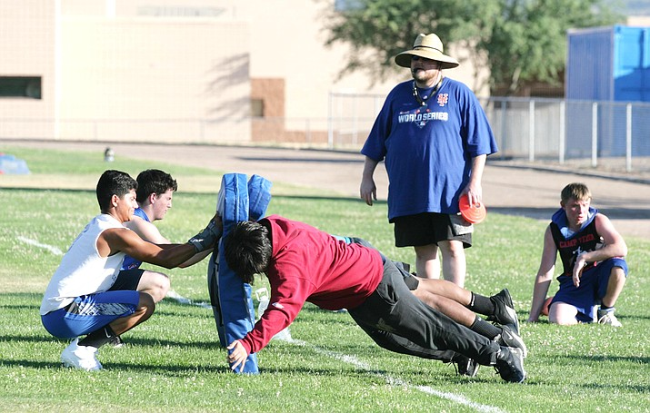 Camp Verde football coach Rick Walsworth watches as his football players work on their blocking during the school's June 22 summer football workouts at Sam Hammerstrom Football Field. VVN/Bill Helm