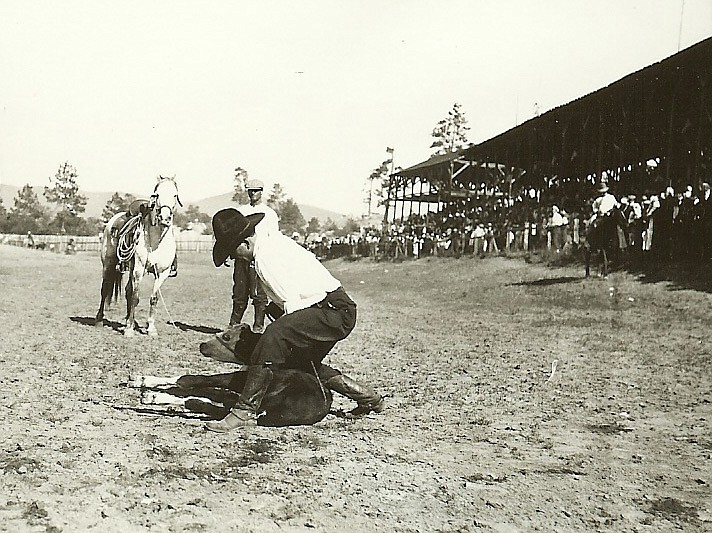 The first Prescott rodeo was held in Forbing Park in Miller Valley in the northwest part of Prescott. Since then, the contests have been held at different locations, including the City Park (now Ken Lindley Field) on East Gurley Street and at other places. Since 1913, it has been held at the present rodeo grounds located just west of Miller Valley Road in Prescott. Pictured is a 1923 calf roping contest. (Sharlot Hall Museum/Courtesy)
