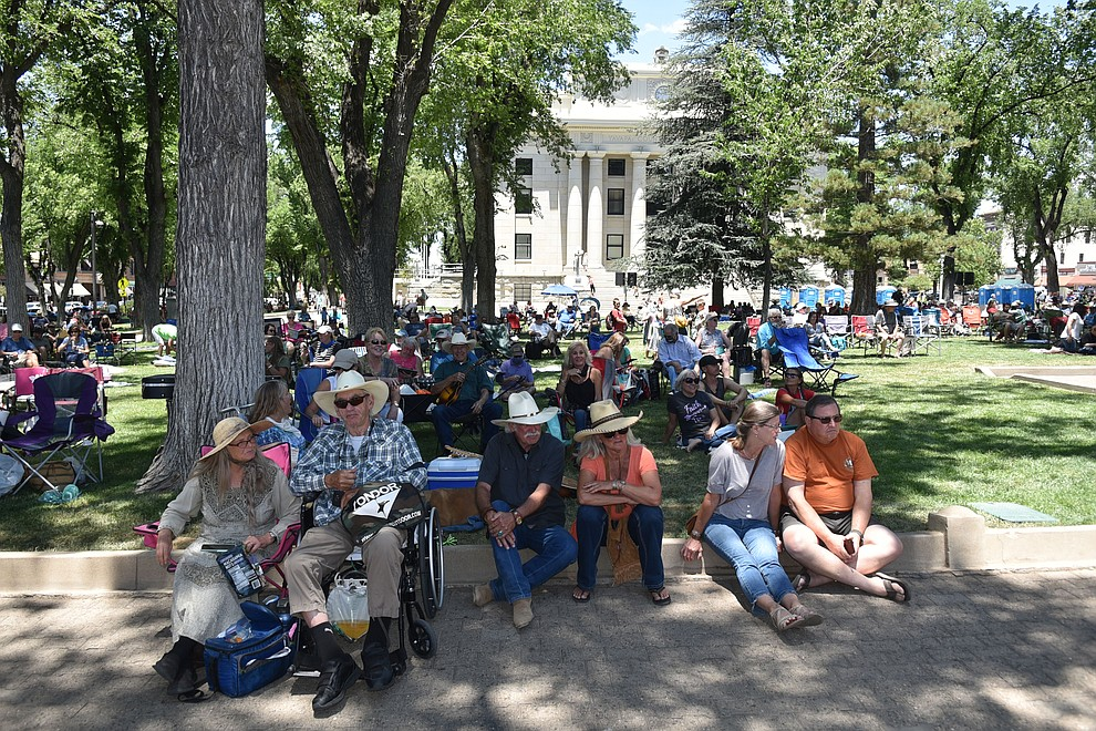 Hundreds gather at the Yavapai County Courthouse for the Prescott Bluegrass Festival. Few are wearing facemasks, despite warnings of Arizona's rising COVID-19 cases, on Saturday afternoon, June 27, 2020. (Jesse Bertel/Courier)