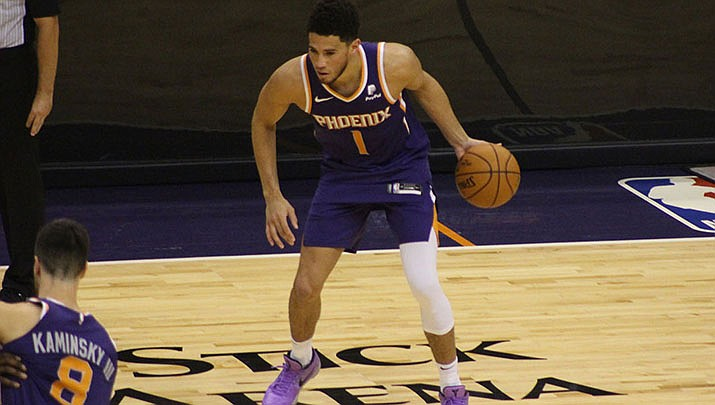 Devin Booker and the Phoenix Suns will be in the running for a playoff spot when the NBA season resumes next month in Orlando, Fla. (Miner file photo)
