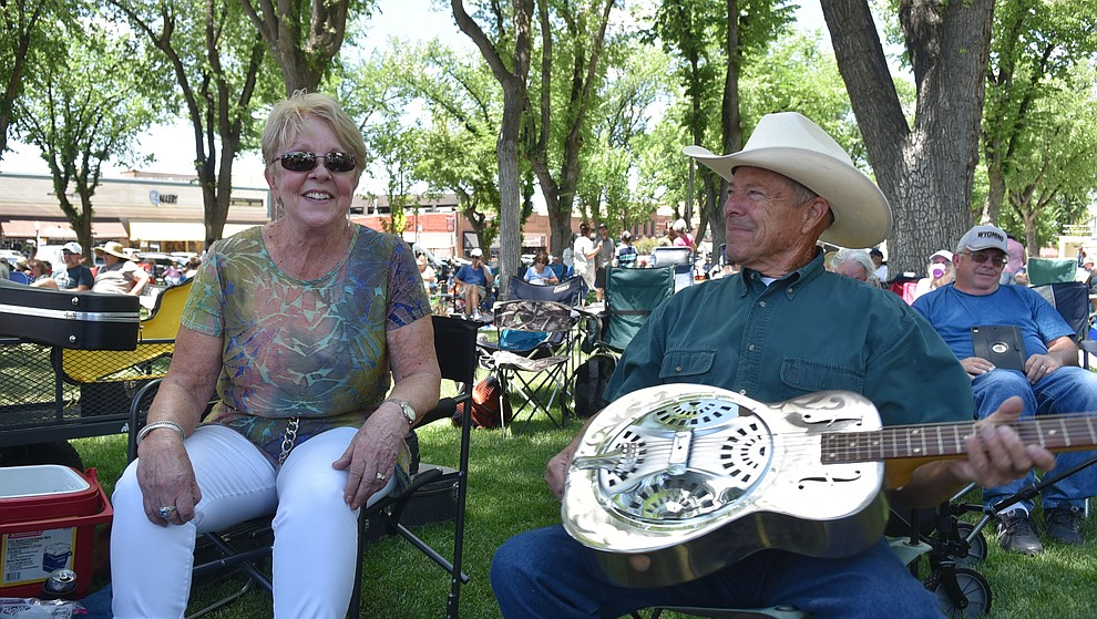 Elaine Mace and Mike Weatherford brought their guitars to strum while watching the Prescott Bluegrass Festival at the Yavapai County Courthouse on Saturday afternoon, June 27, 2020. (Jesse Bertel/Courier)