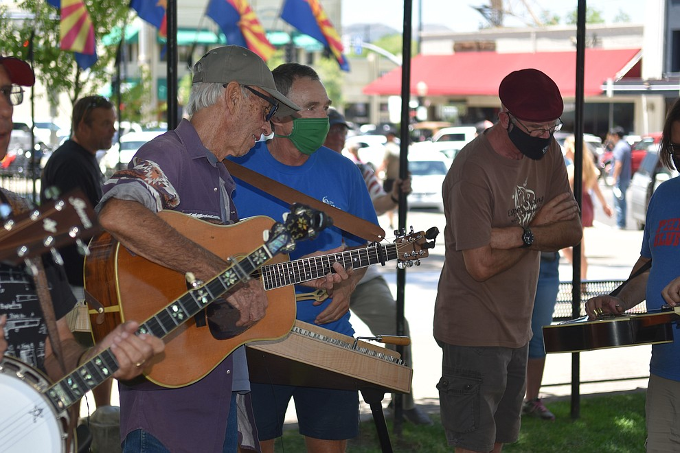 Many attendies brought their guitars to strum while watching the Prescott Bluegrass Festival at the Yavapai County Courthouse. Side jams took place on the other side of the courthouse lawn on Saturday afternoon, June 27, 2020. (Jesse Bertel/Courier)