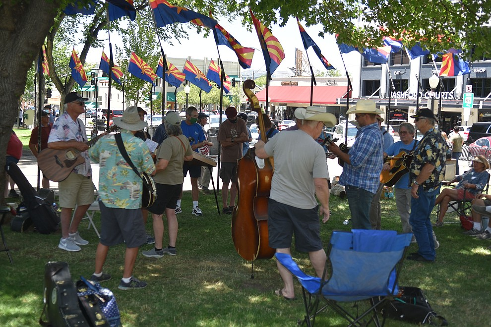 A side jam starts on the other side of the courthouse lawn during the Prescott Bluegrass Festival at the Yavapai County Courthouse on Saturday afternoon, June 27, 2020. (Jesse Bertel/Courier)