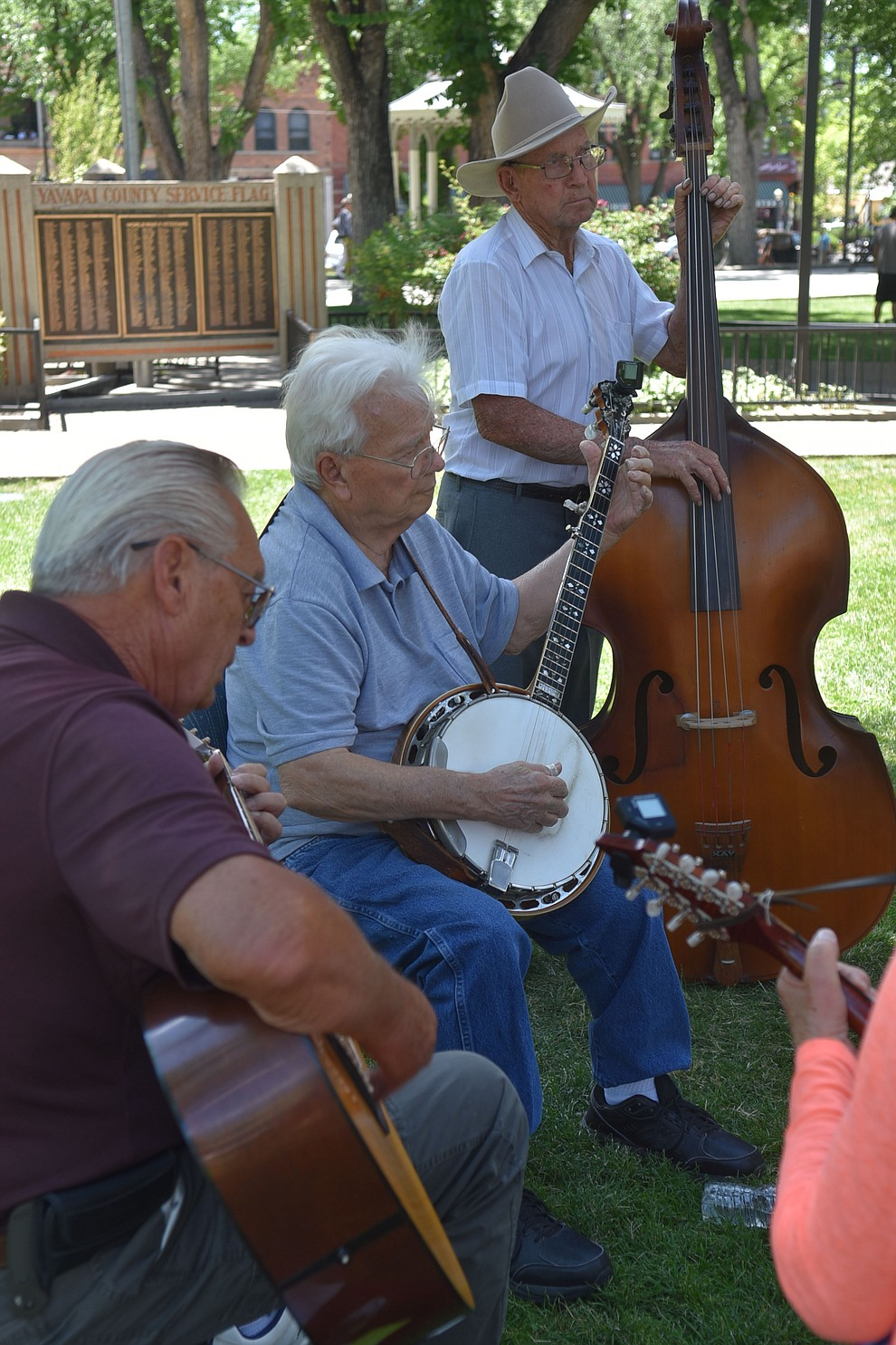 Another side jam takes place on the other side of the courthouse lawn during the Prescott Bluegrass Festival at the Yavapai County Courthouse on Saturday afternoon, June 27, 2020. (Jesse Bertel/Courier)