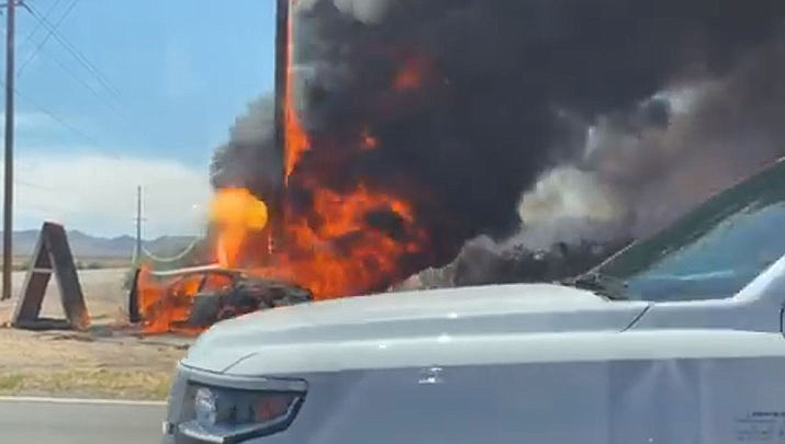 This vehicle crash and fire, which burned a utility pole, caused a power outage on Wednesday, June 24, according to the Mohave Electric Cooperative. (MEC courtesy photo)