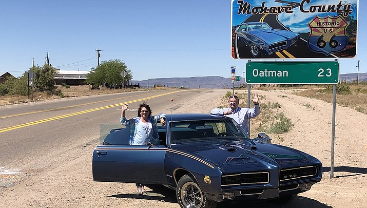 Mohave County Manager Mike Hendrix and his wife Cherie pose beside the new Route 66 road sign off Interstate 40 next to the Oatman Highway exit. (Courtesy photo)