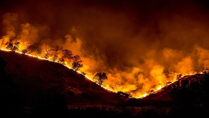 An evacuation notice was issued Saturday for rural area northeast of Tucson because of a wildfire burning brush in a desert valley after coursing across the Santa Catalina Mountains.  (U.S. Forest Service photo/Public domain)
