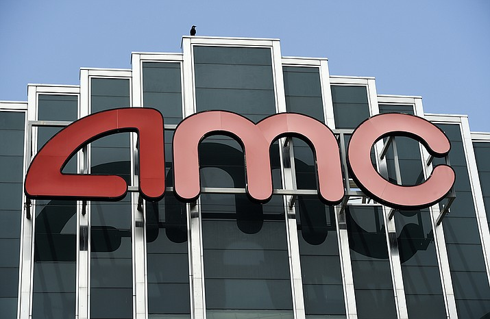 In this April 29, 2020 file photo, the AMC sign appears at AMC Burbank 16 movie theater complex in Burbank, Calif. AMC Theaters, the nation's largest chain, is pushing back its plans to begin reopening theaters by two weeks. The company said Monday that it would open approximately 450 U.S. locations on July 30 and the remaining 150 the following week. (AP Photo/Chris Pizzello, File)