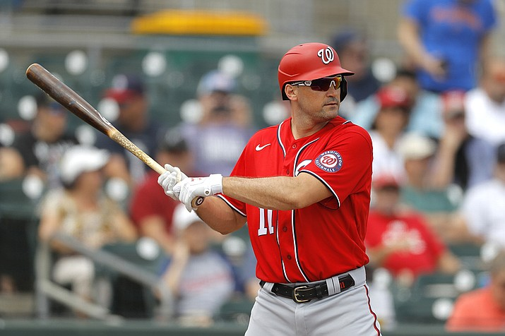 In this Tuesday, March 10, 2020, file photo, Washington Nationals' Ryan Zimmerman waits for a pitch from Miami Marlins pitcher Caleb Smith during the first inning of a spring training baseball game, in Jupiter, Fla. Longtime infielder Ryan Zimmerman and pitcher Joe Ross are opting out of playing the 2020 season as Major League Baseball tries to get back amid the COVID-19 pandemic. General manager Mike Rizzo says the team is 100% supportive of Zimmerman and Ross deciding not to play. (AP Photo/Julio Cortez, File)