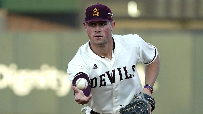 In this Feb. 18, 2020 photo Arizona State infielder Spencer Torkelson makes a play during an NCAA college baseball game in Phoenix, Ariz. The Detroit Tigers agreed to terms Tuesday, June 30, 2020 with No. 1 overall draft pick Spencer Torkelson, and the team said he's joining the player pool for this abbreviated season. (Rick Scuteri/AP)