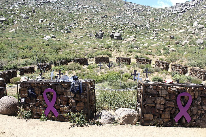 This April 29, 2017 file photo shows the site where 19 firefighters, known as the Granite Mountain Hotshots, died while fighting one of the deadliest wildfires in the state, at the Granite Mountain Hotshots Memorial State Park in Yarnell, Arizona. June 30, 2019, marks seven years since the firefighters died, overrun by flames in a brush-choked canyon. The loss of nearly the entire Granite Mountain Hotshot crew reverberated across the country. (AP Photo/Paul Davenport, File)