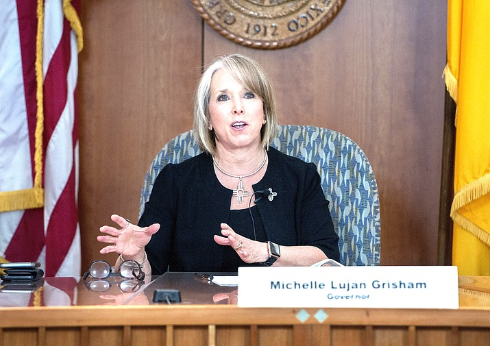 New Mexico Gov. Michelle Lujan Grisham gives an update on the COVID-19 outbreak in the state Capitol during a news conference in Santa Fe, New Mexico. The leader of one of the largest Native American tribes in the U.S. called on Lujan Grisham June 23, to end efforts to fight a court ruling that orders improvements in education for members of his tribe and other vulnerable groups. (Eddie Moore/The Albuquerque Journal via AP, Pool,File)