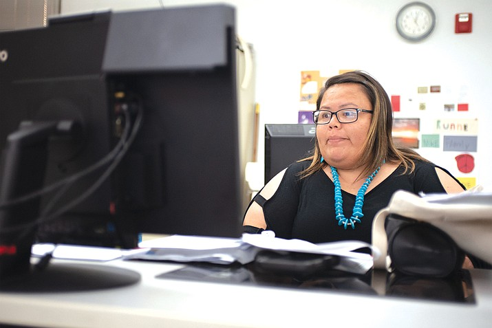 Business Administration major DeeAnna James completes research as a part of a class project at Navajo Technical University. The university is starting a condensed fall semester Aug. 10. (Todd Roth/NHO)