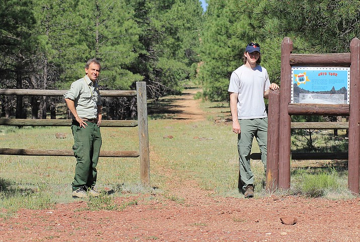 Kaibab National Forest Archaeologist Neil Weintraub and former forest intern Griffin Boehm walk part of the course of the 1928 Transcontinental Footrace on old Route 66 near Parks, Arizona. (Wendy Howell/WGCN)