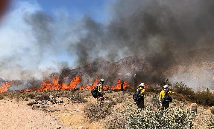 Firefighters battle a small blaze in central Arizona over the weekend. There were about six large wildfires burning around the state Tuesday afternoon. Courtesy of U.S. Forest Service