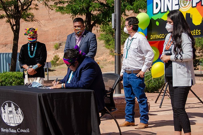 Navajo Nation Council Speaker Seth Damon (seated) signs the 2020 Navajo Nation Diné Pride Week Proclamation June 22, at the Navajo Nation Council Chamber in Window Rock, Arizona. Joining him (standing, left to right) are Diné Pride Board of Directors Member Geronimo Louie, Diné Pride Co-founder and Director Alray Nelson, Council Delegate Carl R. Slater and Council Delegate Charlaine Tso. (Photo courtesy of the Office of the Speaker)