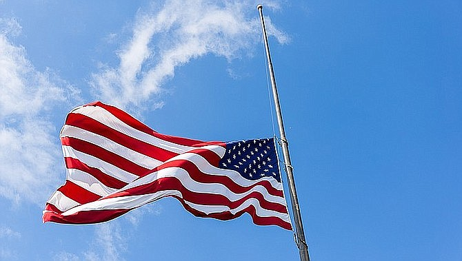 Flags have been ordered at half-staff at all government buildings from sunrise to sunset.