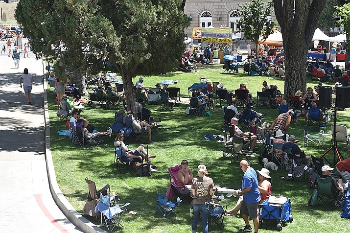 Few attendees of the Prescott Bluegrass Festival, June 27-28, 2020, wore face masks to combat the spread of COVID-19; however, most did socially distance from others on the courthouse plaza in downtown Prescott. (Jesse Bertel/Courier, file)
