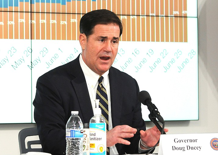 Gov. Doug Ducey during a June 28 media briefing where he reimposing restrictions on certain businesses. (Photo/Howard Fischer)