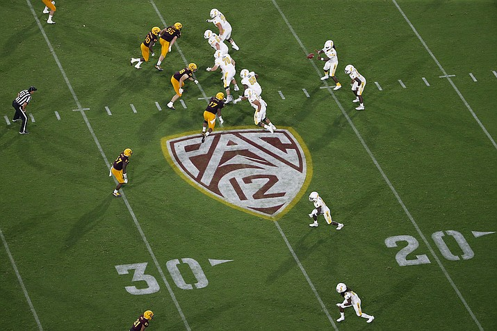 This Thursday, Aug. 29, 2019 photo, shows the Pac-12 logo during the second half of an NCAA college football game between Arizona State and Kent State, in Tempe, Ariz. The Pac-12 has become the second major conference to shift to a conference-only fall schedule amid growing concerns over the coronavirus pandemic. (Ralph Freso/AP, File)