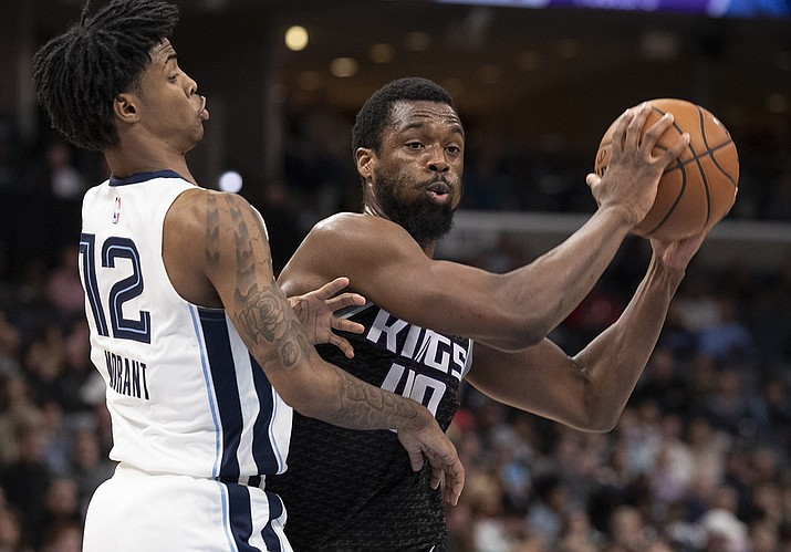 In this Feb. 28, 2020, file photo, Sacramento Kings forward Harrison Barnes (40) looks to pass while defended by Memphis Grizzlies guard Ja Morant (12) during the first half of an NBA basketball game in Memphis, Tenn. Harrison Barnes became the latest NBA player to reveal that he has coronavirus, making the announcement Tuesday, July 14, 2020, and saying he has hopes to join his team at the league's restart later this summer. (AP Photo/Nikki Boertman, File)