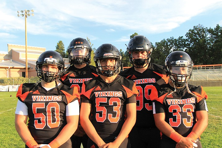 Members of the 2019 Williams Vikings offensive line pose before a game. 2020 high school athletics are in limbo while administrators plan for a modified season because of the coronavirus outbreak. (Wendy Howell/WGCN)
