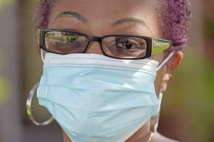 """Parent and teacher Stacey Pugh poses for a photograph outside her home Monday, July 13, 2020, in Humble, Texas. While children have proven to be less susceptible to the coronavirus, teachers are vulnerable. """"I will be wearing a mask, a face shield, possibly gloves, and I'm even considering getting some type of body covering to wear,"""" says Pugh, a fifth-grade teacher in suburban Houston. (David J. Phillip/AP)"""
