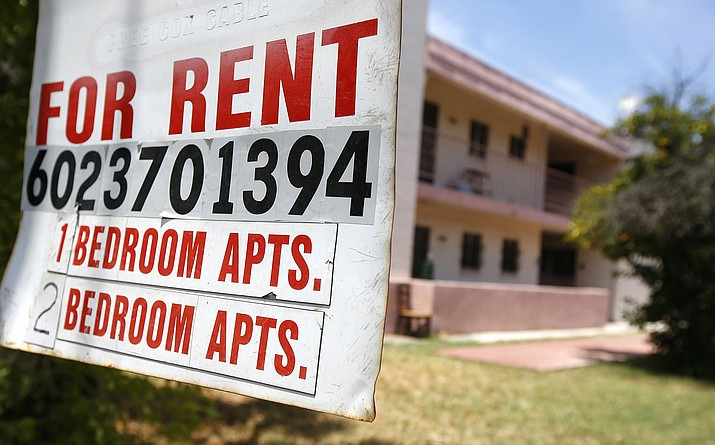 A rental sign is posted in front of an apartment complex July 14, in Phoenix. Housing advocacy groups have joined lawmakers lobbying Arizona Gov. Doug Ducey to extend his coronavirus-era moratorium on evictions when it expires, when the 120-day order ending July 22 was supposed to ensure people would not lose their homes if they fell ill to COVID-19 or lost jobs in the pandemic's economic fallout. (AP Photo/Ross D. Franklin)