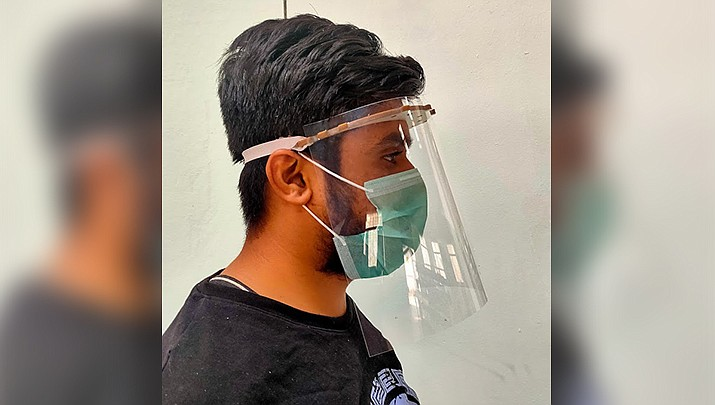 Face shields like the one shown above are now an alternative to face masks for people visiting buildings owned by Mohave County. (Photo by Pooja Jadhav, cc-by-sa-4.0, https://bit.ly/3jem87s)