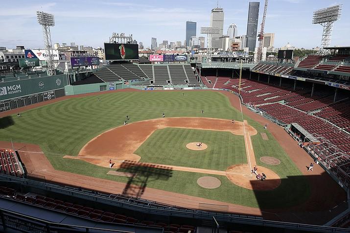 Boston Red Sox baseball players practice at Fenway Park, Thursday, July 16, 2020, in Boston. (Steven Senne/AP)