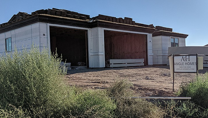 The City of Kingman issued 24 building permits during the week ending July 16. A home is shown under construction on Amada Avenue. (Miner file photo)