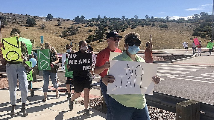 About 60 people gathered at the Yavapai County Juvenile Justice Center along Prescott Lakes Parkway on Friday, July 17, 2020, to protest the county's plans to build a 144-bed jail nearby. The protesters, who carried signs urging the county to rethink the jail plans, walked around the roundabout intersection on the parkway before driving downtown and circling the Yavapai County Courthouse. (Cindy Barks/Courier)