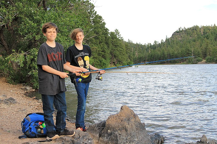Jaydin and Ivan Pensinger enjoy a day of fishing at Santa Fe Reservoir July 16.  Fishermen have been flocking to northern Arizona lakes as the monsoons roll in and termperatures are dropping. (Wendy Howell/WGCN