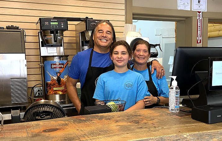 Greg and Melissa Sanez serve up sandwiches with their daughter, Hannah, at Gateway Sandwich Shop in Williams July 15. The restaurant had their Grand Opening July 14. (Wendy Howell/WGCN)