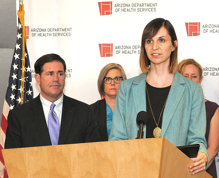 State schools chief Kathy Hoffman at a press conference about COVID-19 earlier this year with Gov. Doug Ducey (Howard Fischer/Capitol Media Services, file)