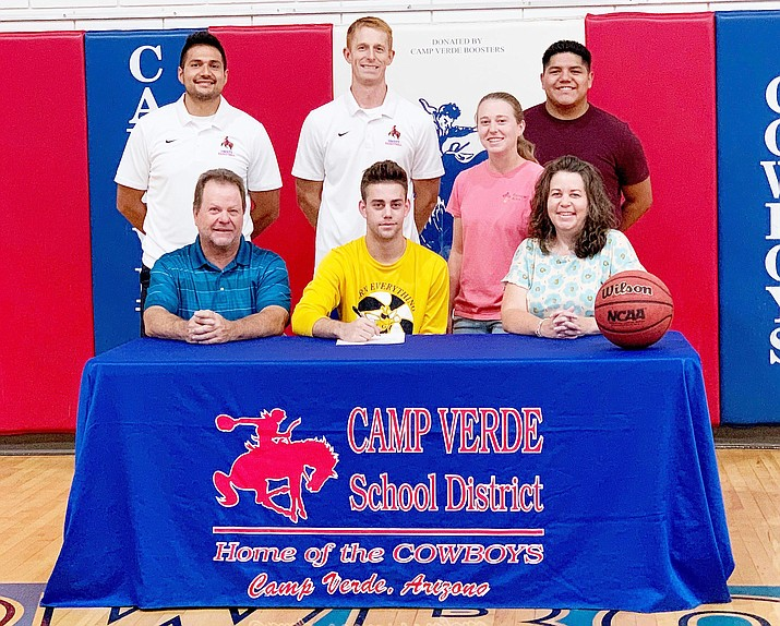 Camp Verde's Jason Collier, front row center, signs a letter of intent to play basketball at Graceland University in Iowa. Collier is pictured with his family and with coaches Jeff Luera, Dan Wall and Reyes Herrera. Courtesy photo