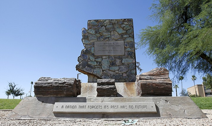 In this June 8, 2020, file photo, is a monument to the region's Confederate troops at a public plaza adjacent to the state Capitol in Phoenix. Two Confederate monuments on Arizona state property, including one at the Capitol, have been removed. A spokeswoman for the Arizona Department of Administration confirmed Thursday, July 23, 2020, that the memorials were taken down overnight and returned to the United Daughters of the Confederacy. (AP Photo/Ross D. Franklin, File)