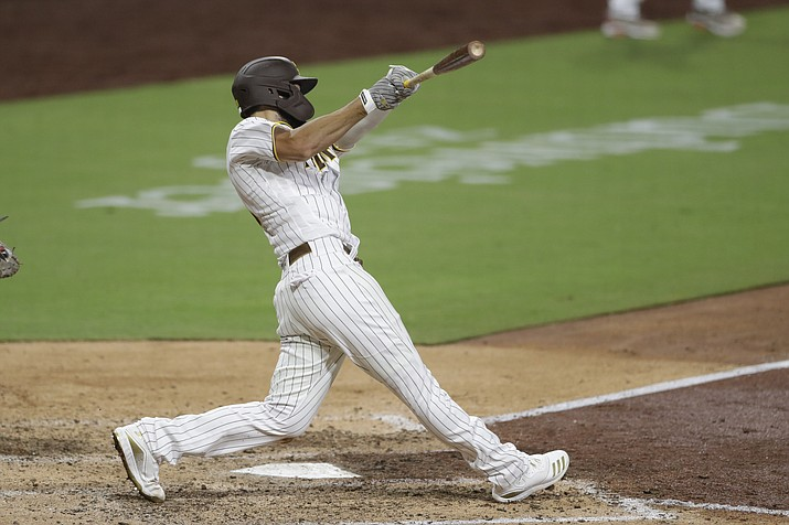 San Diego Padres' Eric Hosmer hits a three-RBI double during the seventh inning of a baseball game against the Arizona Diamondbacks, Friday, July 24, 2020, in San Diego. (Gregory Bull/AP)