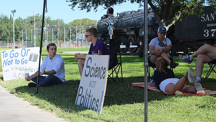 A small group gathered at Locomotive Park in Kingman on Saturday, July 25 to protest in favor of opening schools for in-school instruction. (Photo by Agata Popeda/Kingman Miner)